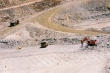 Mining Photo Stock Library - excavator and truck rotation working in gold mine.  blast drill holes in foreground.  aerial image. ( Weight: 1  New Image: NO)