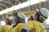 Mining Photo Stock Library - mine construction workers in full PPE observing construction work inside building plant. ( Weight: 1  New Image: NO)