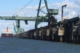 Mining Photo Stock Library - close up photo of ship loader loading coal into ship at wharf.  shot from water level behind the ship. ( Weight: 1  New Image: NO)