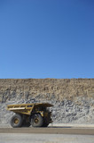 Mining Photo Stock Library - generic vertical shot of a coal haul truck in open cut mine. blue sky and high walls behind.