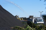 Mining Photo Stock Library - water cart spraying water onto coal stockpile to reduce dust suppression. ( Weight: 1  New Image: NO)
