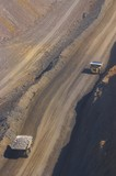 Mining Photo Stock Library - two haul trucks on haul access road in open cut mine site.  aerial vertical photo. ( Weight: 1  New Image: NO)