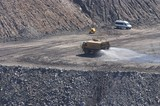 Mining Photo Stock Library - water cart spraying water as dust suppression in open cut coal mine site. ( Weight: 1  New Image: NO)
