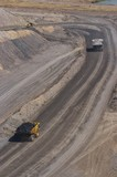 Mining Photo Stock Library - loaded haul truck with coal following haul truck with overburden in open cut coal mine.  aerial portrait shot. ( Weight: 1  New Image: NO)