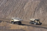 Mining Photo Stock Library - Two loaded haul trucks pass on haul road in open cut coal mine. Queensland Bowen Basin ( Weight: 1  New Image: NO)