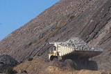 Mining Photo Stock Library - close up photo of loaded haul truck in open cut coal mine.  blue sky behind. ( Weight: 1  New Image: NO)