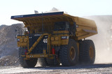 Mining Photo Stock Library - haul truck loaded with overburden shot head on with excavator in background.  open cut coal mine. ( Weight: 1  New Image: NO)
