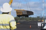 Mining Photo Stock Library - mine site haul truck tray suspended by crane in workshop area.  worker in full PPE looking on. ( Weight: 1  New Image: NO)