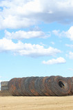 Mining Photo Stock Library - vertical shot of a truck tyre stockpile of haul trucks at a mine site.  blue sky in the background. ( Weight: 1  New Image: NO)