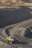Mining Photo Stock Library - vertical photo of a loaded haul truck driving around a corner and up a ramp in an open cut coal mine. ( Weight: 1  New Image: NO)
