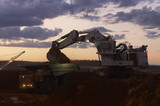 Mining Photo Stock Library - excavator loading overburden into a haul truck in an open cut coal mine.  late afternoon dusk image. ( Weight: 1  New Image: NO)