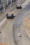 Mining Photo Stock Library - light vehicle passing two 2 haul trucks on access road in open cut coal mine.  aerial photo. ( Weight: 1  New Image: NO)
