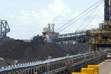 Mining Photo Stock Library - close up photo of coal reclaimers working large stockpiles at coal shipping terminal. ( Weight: 1  New Image: NO)