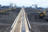 Mining Photo Stock Library - wide aerial shot of a coal terminal.  Reclaimers working coal stockpiles.  light vehicles on access road give scale. ( Weight: 1  New Image: NO)