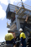 Mining Photo Stock Library - two 2 mine workers in full PPE inspecting a coal hopper at a mine site. ( Weight: 1  New Image: NO)