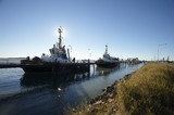 Mining Photo Stock Library - tugboats berthed at wharf in early morning light.  blue sky behind. ( Weight: 1  New Image: NO)