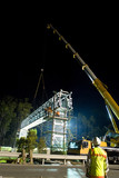 Mining Photo Stock Library - civil worker supervising gantry being lifted into palce by crane.  workers on scaffold fitting gantry into place.  night time works. ( Weight: 1  New Image: NO)