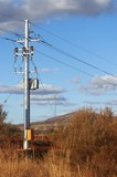 Mining Photo Stock Library - remote electricity pole carrying power overland to mine site.  shot in early morning light. ( Weight: 1  New Image: NO)