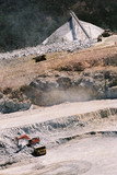 Mining Photo Stock Library - aerial photo of haul trucks being loaded in open cut mine site.  product stockpile in background. ( Weight: 1  New Image: NO)