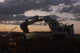 Mining Photo Stock Library - great dusk shot of excavator loading a haul truck.  generic dusk photo.  machines with lights on. ( Weight: 1  New Image: NO)