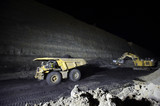 Mining Photo Stock Library - night time photo of truck and digger in open cut coal mine. loaded truck is moving. high wall and coal seam in background. ( Weight: 1  New Image: NO)