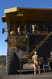 Mining Photo Stock Library - mine site worker in full PPE  performing maintenance on haul truck at workshop in coal mine. ( Weight: 1  New Image: NO)