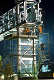 Mining Photo Stock Library - infrastructure workers in full PPE including harness working off scaffolding at a bridge gantry site.  photo taken at night. ( Weight: 1  New Image: NO)