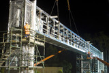 Mining Photo Stock Library - workers in full PPE installing a gantry bridge over a motorway during the evening.  Scaffolding installed on both sides of the bridge. ( Weight: 1  New Image: NO)