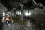 Mining Photo Stock Library - underground coal mine worker engineer walking through tunnel with coal conveyors moving above.  qide photo. ( Weight: 1  New Image: NO)
