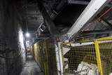 Mining Photo Stock Library - underground conveyor belt and ducting work.  mine site worker walking in background gives scale. ( Weight: 1  New Image: NO)