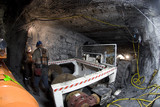 Mining Photo Stock Library - workers in full PPE working together in underground coal mine.  mine machinery truck nearby. ( Weight: 1  New Image: NO)
