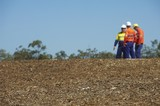 Mining Photo Stock Library - three mine site workers in full PPE in discussion.   ( Weight: 1  New Image: NO)