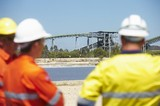 Mining Photo Stock Library - three workers in full PPE in discussion with coal conveyors in background.  workers out of focus in foreground. ( Weight: 1  New Image: NO)