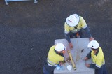 Mining Photo Stock Library - aerial photo of three mine site workers discussing work. ( Weight: 1  New Image: NO)