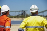 Mining Photo Stock Library - two  mine site construction workers looking across a site.  large conveyor and stock pile in background. ( Weight: 1  New Image: NO)