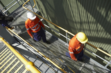 Mining Photo Stock Library - photo of two mine site workers in full PPE walking up stairs.  faces cannot be seen. ( Weight: 1  New Image: NO)