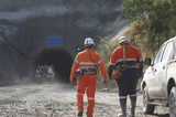 Mining Photo Stock Library - photo of two underground workers walking towards the portal.  light vehicle 4wd driving down the mine site entrance. ( Weight: 1  New Image: NO)
