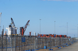 Mining Photo Stock Library - photo of temporary fencing around ship at port.  shipping containers stacked on wharf.  bluer sky behind. ( Weight: 1  New Image: NO)