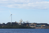 Mining Photo Stock Library - great photo of a large wind generator and in the background is a reclaimer loading stockpiles of coal.  large dam in foreground. ( Weight: 1  New Image: NO)