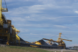 Mining Photo Stock Library - photo of large shiploader and reclaimer working on coal stockpiles. light vehicle sealed road in foreground ( Weight: 1  New Image: NO)