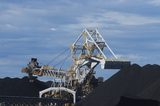 Mining Photo Stock Library - close up photo of coal reclaimer next to stockpile.  blue sky behind. ( Weight: 1  New Image: NO)