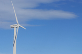 Mining Photo Stock Library - close up photo of large wind generator.  blue sky behind. ( Weight: 1  New Image: NO)
