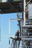 Mining Photo Stock Library - mine worker in full PPE walking down stairs from conveyor site. ( Weight: 1  New Image: NO)