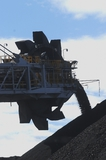 Mining Photo Stock Library - close up silhouette of a coal loader stockpiling coal. ( Weight: 1  New Image: NO)