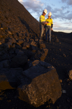 Mining Photo Stock Library - close up photo of coal with mine workers male and female in full PPE in background out of focus.  shot at dusk with great afternoon light.  vertical photo. ( Weight: 1  New Image: NO)